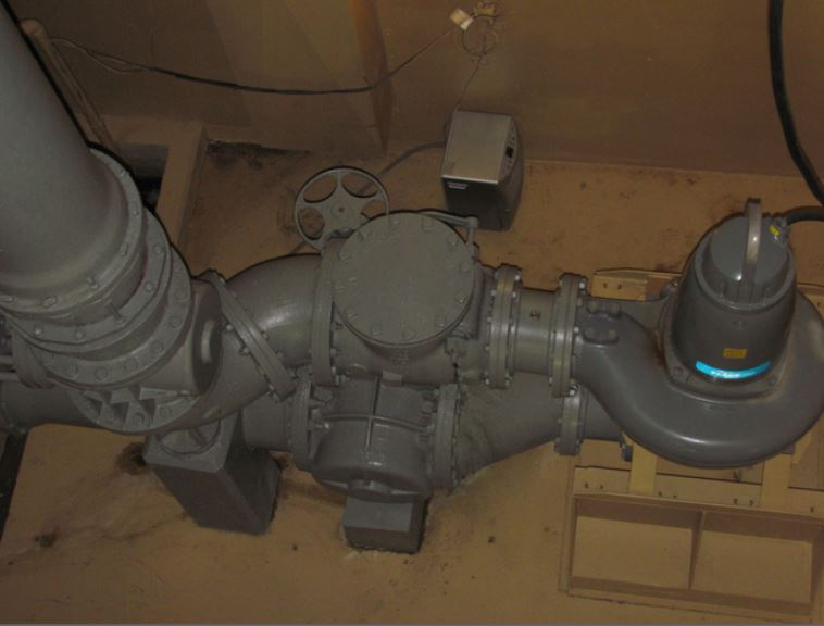RAS flygt submersible dry pit pump retrofit of conventional pumps looking down replacing tangential discharge
